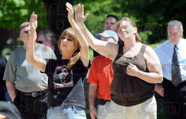 Passionate: The National Day of Prayer participants get into the event Thursday afternoon at Terre Haute City Hall.