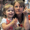 There: Two-year-old Camryn Lynn and her mother Robyn wait for their graduate to cross the stage during Ivy Tech Commencement ceremonies at Hulman Center.