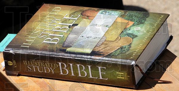 Bible detail: Photo of Bible sitting on a bench next to a National Prayer Day participant at Terre Haute City Hall Thursday afternoon.