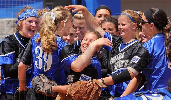 Shutout win: Her teammates congratulate ISU senior Meagan McCurdy on her shutout win over Wichita State Sunday afternoon.