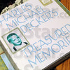 Memories: Mike Decker brought a scrap book of his childhood to show his mother and newfound family about his life Friday afternoon.