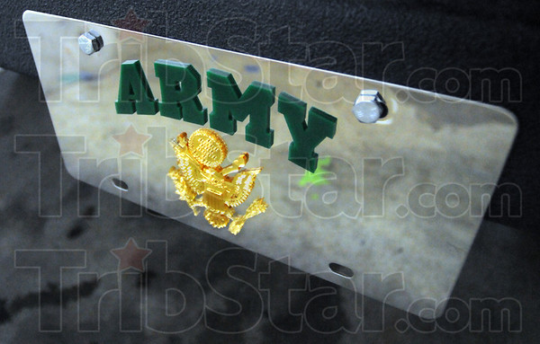 License: Detail photo of Army license plate on the front of the Griffin Ford Bronco.