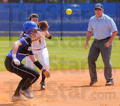 Back and forth: ISU baserunner Kim Pierce is caught in a rundown. Waiting for the throw is the Shockers' Kara L'Huillier
