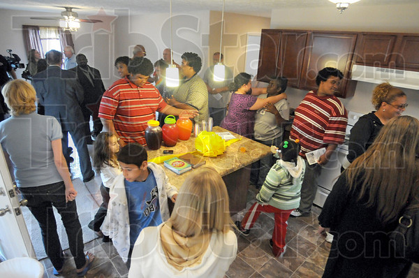 Open house: Habitat supporters tour the house at 931 Gilbert Avenue Sunday afternoon.