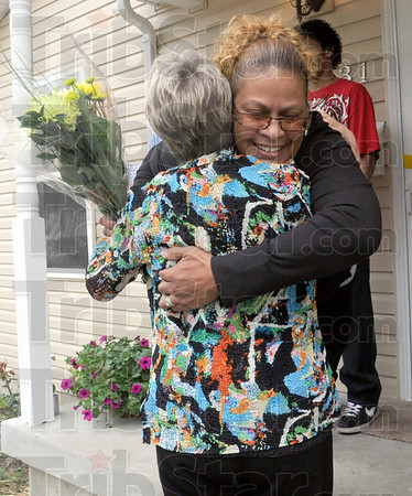 Happy hugs: Mercedes Estremera hugs one of her supporters after being presented with the keys to the Habitat Home at 931 Gilbert Avenue Sunday afternoon.