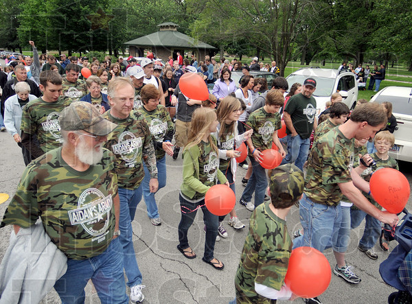 Army of walkers: A large group of walkers leave the starting line in Deming Park Sunday afternoon.