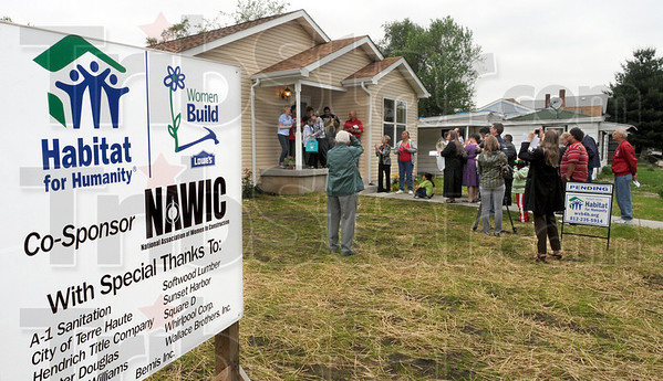 Women Build: Habitat supporters gather Sunday afternoon to present the keys to the 54th Habitat Home built in the Wabash Valley to Carlos Hernandez, Mercedes Estremera and their two sons.