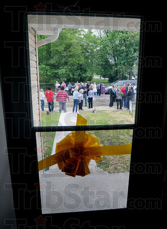 Ribbon: A yellow ribbon stretches across the front entrance to the 54th Habitat home built in the Wabash Valley located at 931 Gilbert Avenue Sunday afternoon. Carlos Hernandez, Mercedes Estremera and their two sons Jeremiah and Matthew received the keys to their new home.