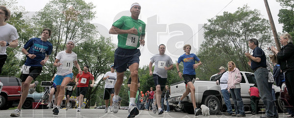 They're off: Runners leave the starting line at the Cystic Fiberosis event Sunday afternoon at Deming Park.