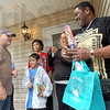 Keys: Pat Brown (L) presented the keys to the Habitat Home to Carlos Hernandez, Mercedes Estremera and their two sons, Jeremiah and Matthew Sunday afternoon. Pat was the building site coordinator on the project.