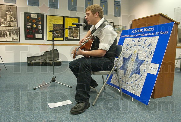 "For Eva: Singer-songwriter Joe Valerius sings his ""Song for Eva Kor"" during the 15th Anniversary Commemoration of the CANDLES museum Sunday afternoon."