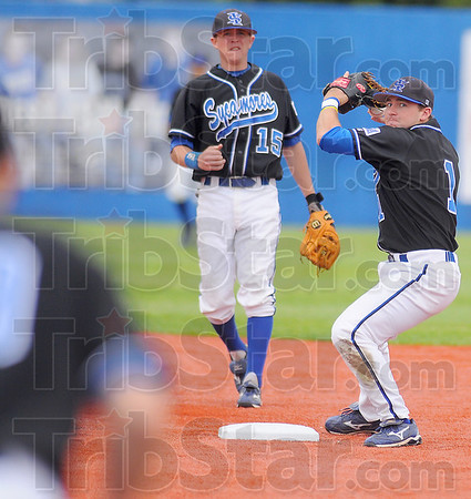 Double play: Sycamore second baseman Grant Grgurich looks to first base to finish a double play. Shortstop Ben Ferrell watches.