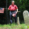 Memorial: Lost Creek trustee Rick Long searches for veteran's gravesites in the Patterson Cemetery in Seelyville Friday afternoon.