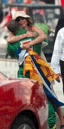 A hug for a friend: Tony Kanaan of Team 7-Eleven hugs Ashley Judd, the wife of 2010 Indianapolis 500 winner, Dario Franchitti, after the race Sunday in Indianapolis.