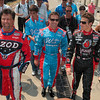 It's a family tradition: Michael Andretti, John Andretti and Marco Andretti leave their team's garage to go to their cars before the start of the Indianapolis 500 Mile Race Sunday in Indianapolis.
