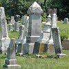 Hull Cemetery: Tombstones lean in various directions atop a hill in Hull Cemetery.