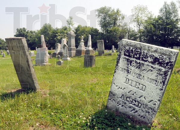 Shifting ground at the Hull Cemetery has left tombstones reaching in all directions.