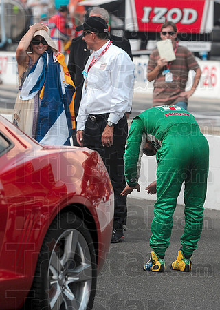 A bow for the winners: Team 7-Eleven driver Tony Kanaan jokingly bows before Ashley Judd after her husband, Dario Franchitti, won the 2010 Indianapolis 500 Mile Race Sunday in Indianapolis.