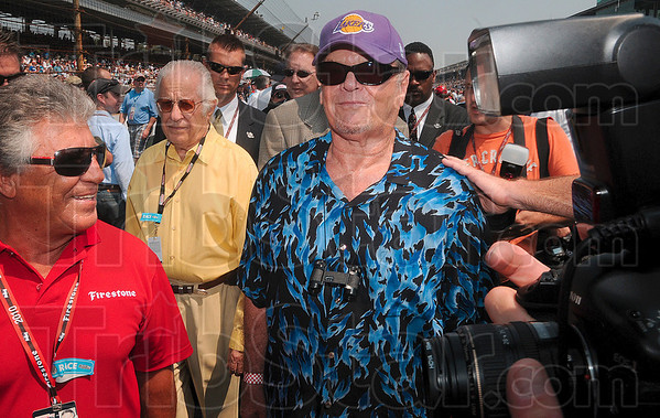 One famous Lakers fan: Movie star Jack Nicholson walks through the pit area with Mario Andretti, left, before the start of the 2010 Indianapolis 500 Mile Race Sunday.