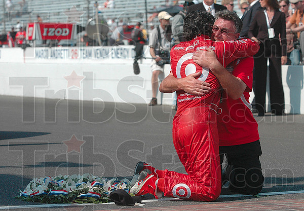 Indianapolis 500 Mile Race winner Dario Franchitti receives a hug from a Target Chip Ganassi Racing member Sunday after the race in Indianapolis.
