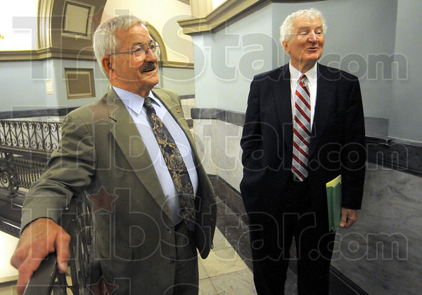 """Relieved: Turk Roman (L) talks with well-wishers after his sentencing in Division #6 Court Friday afternoon. Roman's attorney Bob Wright joins in the conversation. Roman's charges were reduced to a class """"A"""" misdemeanor from a """"D"""" felony."""