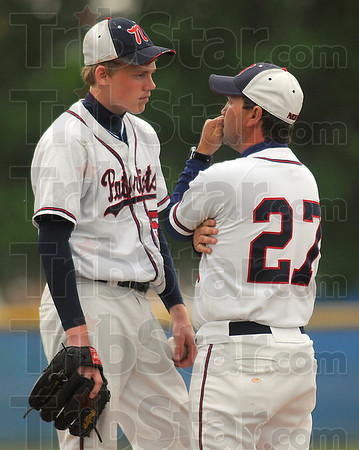 Can we talk: Terre Haute North pitcher Bryan Nacke and coach Shawn Turner discuss Nackes' pitching during a break in the action in the Patriots' game with Center Grove Friday evening.