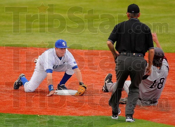 Waiting: ISUs Ben Ferrell waits with a gloved ball for Missouri State Baserunner Tyler Ryun to reach him for the tag.