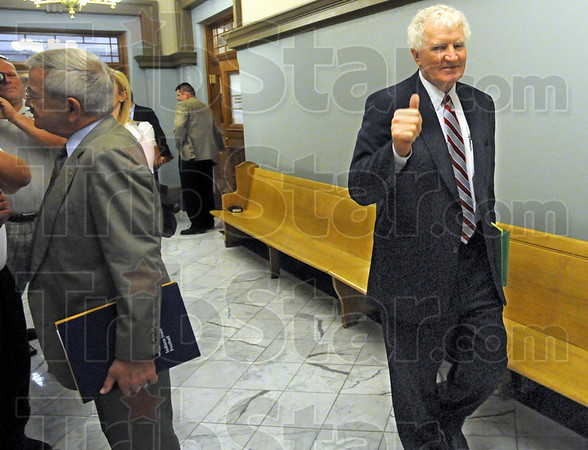 "Happy with outcome: Terre Haute attorney Bob Wright gives the ""thumbs up"" as his client Turk Roman stops to talk with media Friday afternoon after his sentencing in Vigo County Court. Roman's offense was reduced to a class ""A"" misdemeanor."
