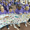 Survivors: A large group of cancer survivors take the first lap of the annual Vigo County Relay For Life event at Rose-Hulman Friday evening.