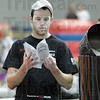 Smoke instructions: Rose-Hulman student Steve Ricks checks a cooking instruction book that goes with a BBQ/smoker being auctioned at the annual Vigo County Relay For LIfe.