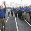 Thanks: Best Buy general manager Mike Piotrowski waves to the people standing in line to be the first inside the new store Friday morning.