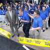 Open for business: Best Buy employee Jeremy Hopkins cuts the ribbon to officially open the new store for business Friday morning. At left is Mayor Duke Bennett and at right is Best Buy general manager Mike Piotrowski.