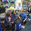 3-D: A Best Buy associate shows the new 3-D system to customers during Friday's first day of business.