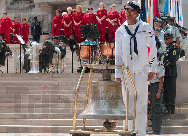 Tribune-Star/Joseph C. Garza<br /> For whom the bell tolls: Logistics Specialist Third Class Ariana Polk of Navy Operational Support Center Indianapolis rings the ship's bell from the battlecruiser, the USS Indianapolis (CA-35), after Sgt. Dale Griffin's name was read during the 500 Festival Memorial Service Friday in Indianapolis.