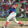 Bub-bye: Linton's #32, Stephanie Fougerousse watches the ball leave the park just inside the left field pole as she hit the first of two home runs. The latter being a bases-loaded grand slam in the seventh inning.