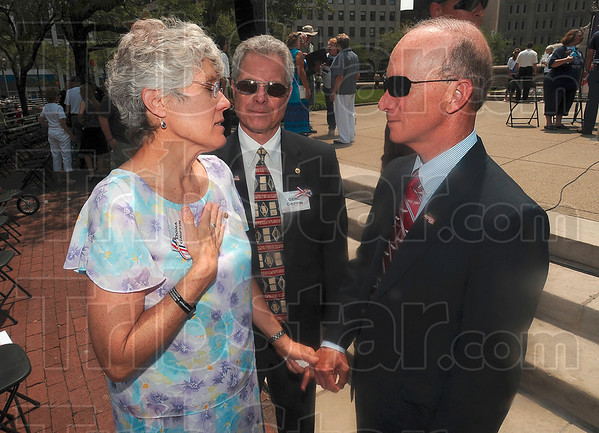 Tribune-Star/Joseph C. Garza<br /> A heartfelt thanks: Dona Griffin, the mother of the late US Army Sgt. Dale Griffin, and her husband, Gene Griffin, thank Gov. Mitch Daniels for his support after Dale's death in 2009 after the 500 Festival Memorial Service Friday in Indianapolis.