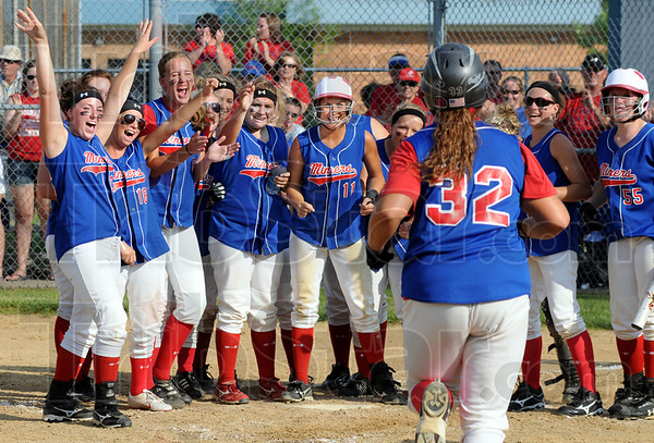 Welcome Home (run): Linton's #32, Stephanie Fougerousse is about to jump onto home plate after hitting a home run during South Knox sectional play against Bloomfield.
