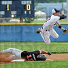Force out: North's #17, shortstop Parker Fulkerson forces South's #12, Brent Mulvihill out at second base and fires the ball to first for a double-play attempt. The ball was wide to the first baseman and the batter was safe.