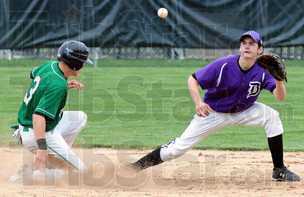 Beat it: West Vigo's #3, Tyler Wampler makes it to second base ahead of the throw to #14, Chris Hoult during game action against Georgetown Saturday morning.
