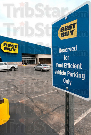 Tribune-Star/Joseph C. Garza<br /> Blue, yellow and green: A sign in front of the new Best Buy lets motorists know that a certain space is reserved for fuel efficient models.