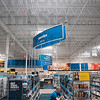 Tribune-Star/Joseph C. Garza<br /> Energy saving: Best Buy employee Parker Schaffer stocks the shelves in the Blu-Ray section under a sky light in the new store in Towne South Plaza.