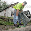 Volunteer: Terre Haute resident Phil Thompson picks up litter just north of Wabash Avenue on 20th Street Saturday morning as he participates in the annual clean-up event.