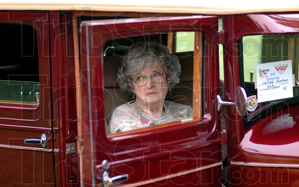 Driving Miss Daisey: Cathy Havercamp relaxes in the front passenger seat of her 1929 Packard Saturday afternoon during the Wabash Valley Corvette Club 2010 Spring Fling car show at Collett Park. She and her husband Jim are owners and builders of the vehicle.