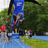 High flier: Tray Wilson leaps in the long jump competition Saturday.