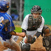 I've been waiting: West Vigo catcher Brody McCalister prepares to tag Brown County baserunner Que Stuart.