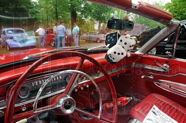 "Fuzzy dice: A 1963 Ford Falcon convertible sports a set of ""fuzzy dice"" at Saturday's fundraising event at Collett Park. The show was sponsored by the Wabash Valley Corvette Club with all proceeds going to Happiness Bag."