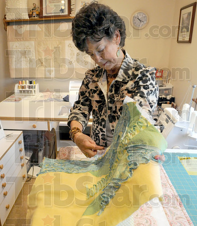 At work: Kay Bozarth works on a custom piece in her home studio.