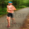 Tribune-Star/Joseph C. Garza<br /> Finishing with a run: Triathlete Scott Jerden races under the trees at Hawthorn Park during the running portion of the Terre Haute Triathlon Saturday, May 22.