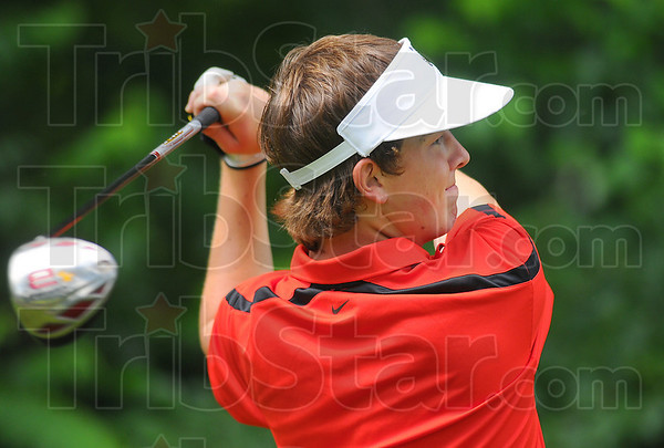 Tee time: Terre Haute South #2 golfer Shelby Stewart watches his drive on the front nine Saturday in the MIC championship match at Hulman Links.