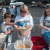 Tribune-Star/Joseph C. Garza<br /> For the ones in need: Volunteers Noah Pursch, Connie Sisson, and Carrie Chase fill bags with rice, protein, vitamins, spices and dried vegetables as part of a relief effort for Haiti Saturday at Cross Lane Community Church.
